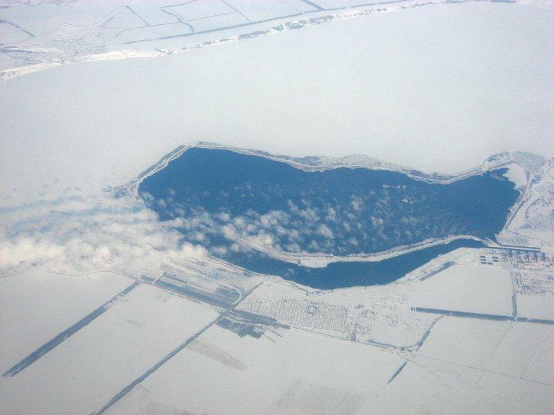 Вид из окна самолёта зимой